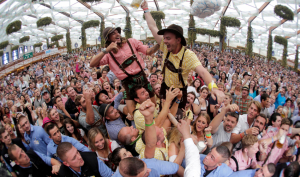 People celebrate the opening of the 181th Oktoberfest beer festival in Munich, southern Germany, Saturday, Sept. 20, 2014. The world's largest beer festival will be held from Sept. 20 to Oct. 5, 2014. (AP Photo/Matthias Schrader) ORG XMIT: MAS116